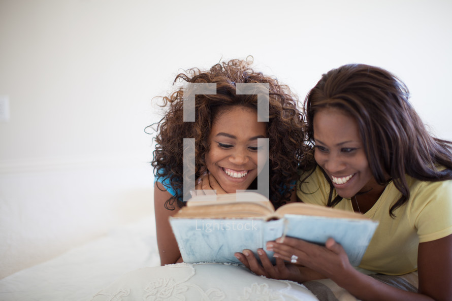 mother and daughter reading a Bible together