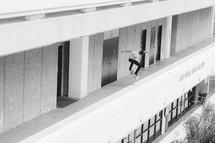 Skateboarding off a ledge.