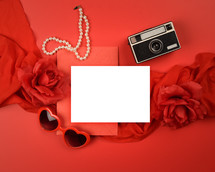 red background, white envelope, hearts, roses, pearls, camera