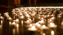flickering prayer candles at a vigil
