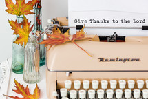 give thanks to the lord in type on a typewriter