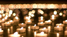 flickering prayer candles