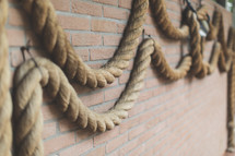 Heavy rope on a brick wall.