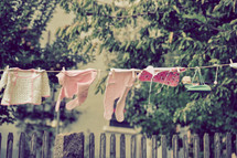infant clothes on a clothesline