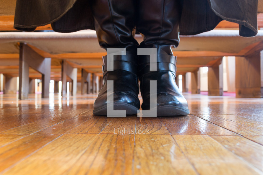 boots under church pews