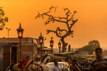 crowded village in India at sunset