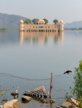 a building surrounded by water in India