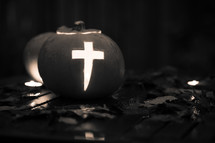 Pumpkin with a cross carved into it