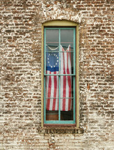 old glory hanging in a window