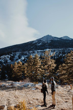 a couple hiking in the mountains in winter