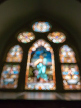 blurry stained glass window in a church