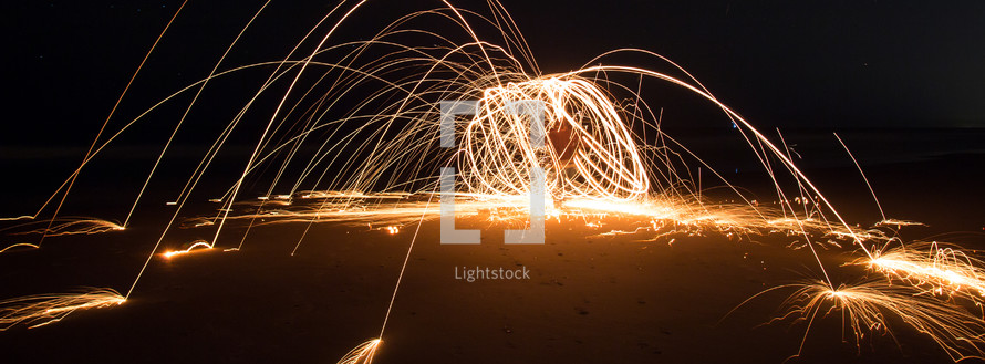 light play on a beach at night