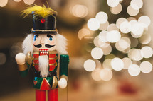 nutcracker and Christmas tree lights