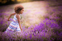 a little girl running in a lavender field