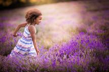 a little girl running in a lavender field