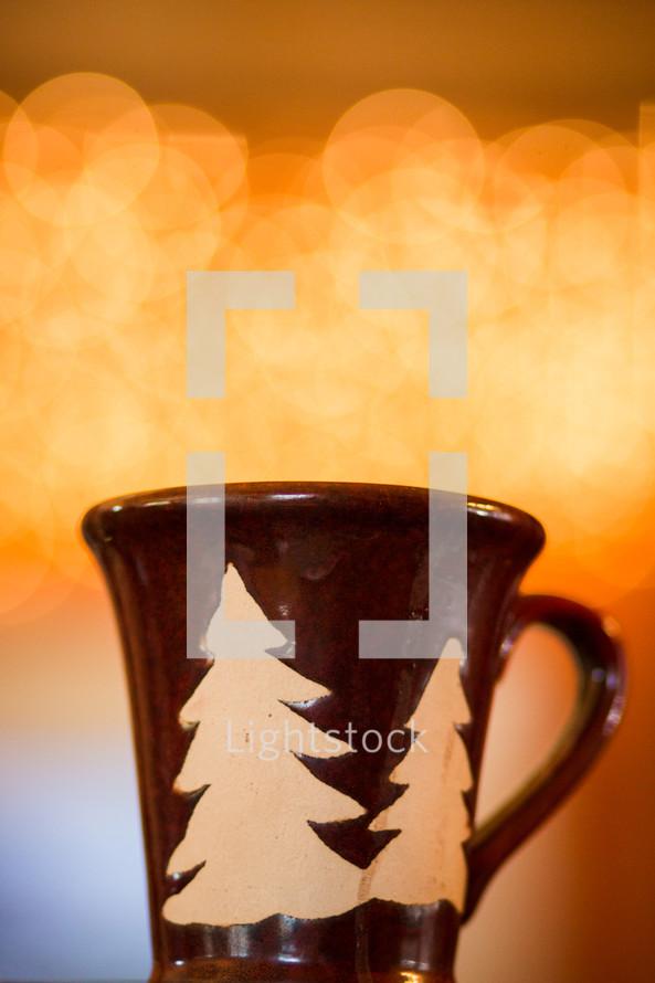 a winter mug in front of bokeh lights