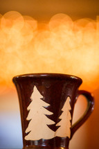 a winter mug in front of bokeh lights