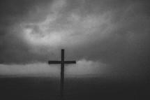 Cross under a stormy sky.