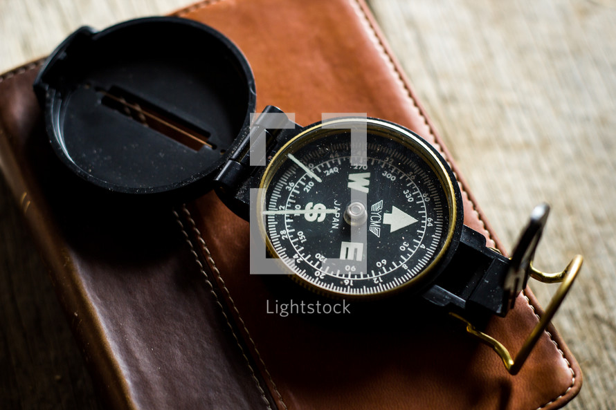 compass on a leather bound Bible