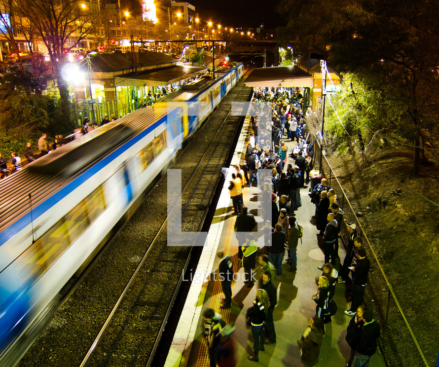 people waiting on a commuter train