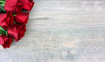 red roses on a wood background
