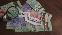 magnifying glass over money and possessions