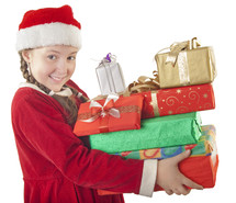girl child in a Santa hat holding Christmas presents