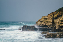 The ocean and a rocky shore.