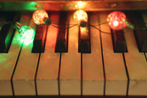 retro coloured lights illuminate a vintage piano