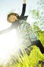 girl child jumping for joy