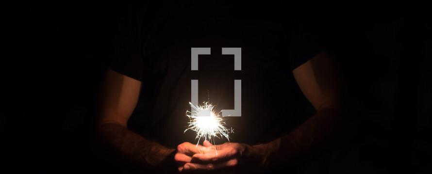 man holding a sparkler
