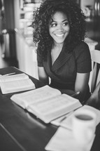 woman at a Bible study smiling