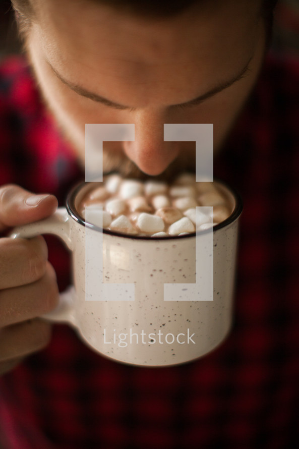 a man drinking hot cocoa