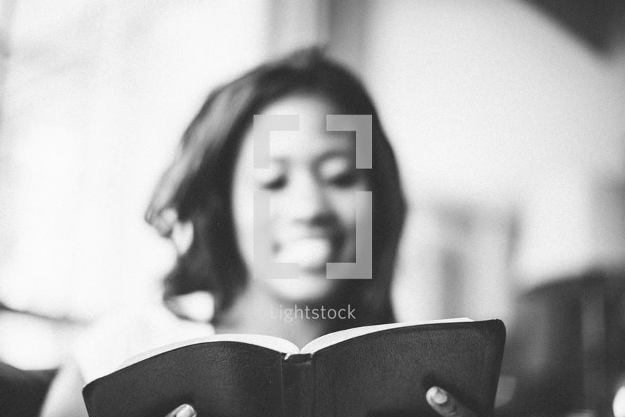 woman reading a Bible