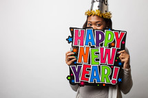 Woman holding a Happy New Year sign.