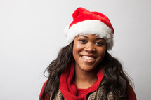 A woman wearing a Santa hat