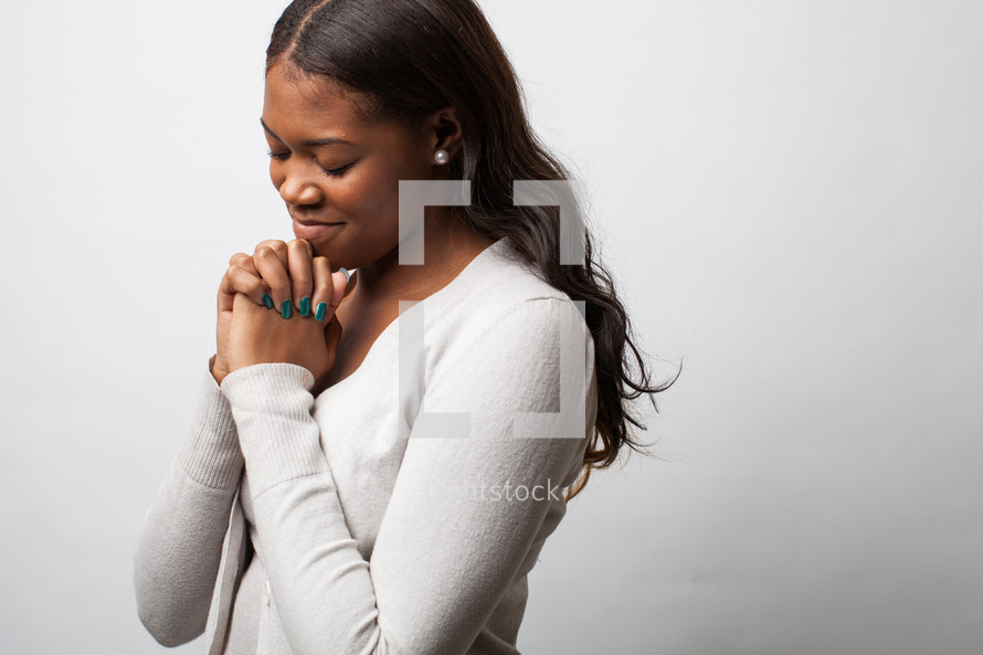 A woman in prayer.
