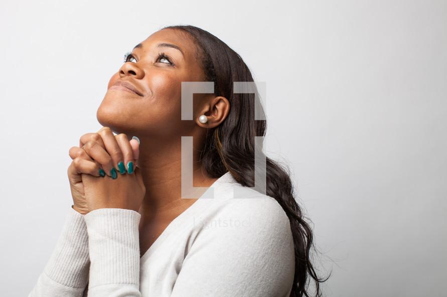 A woman in soulful prayer.