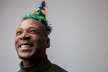 man in a party hat