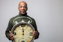 man holding a clock