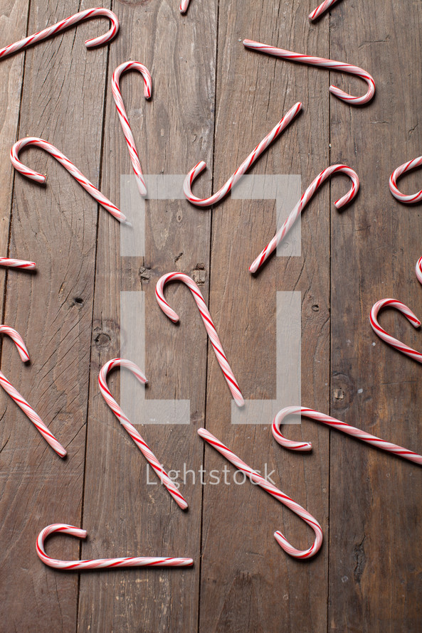 candy canes spread out of a wood floor