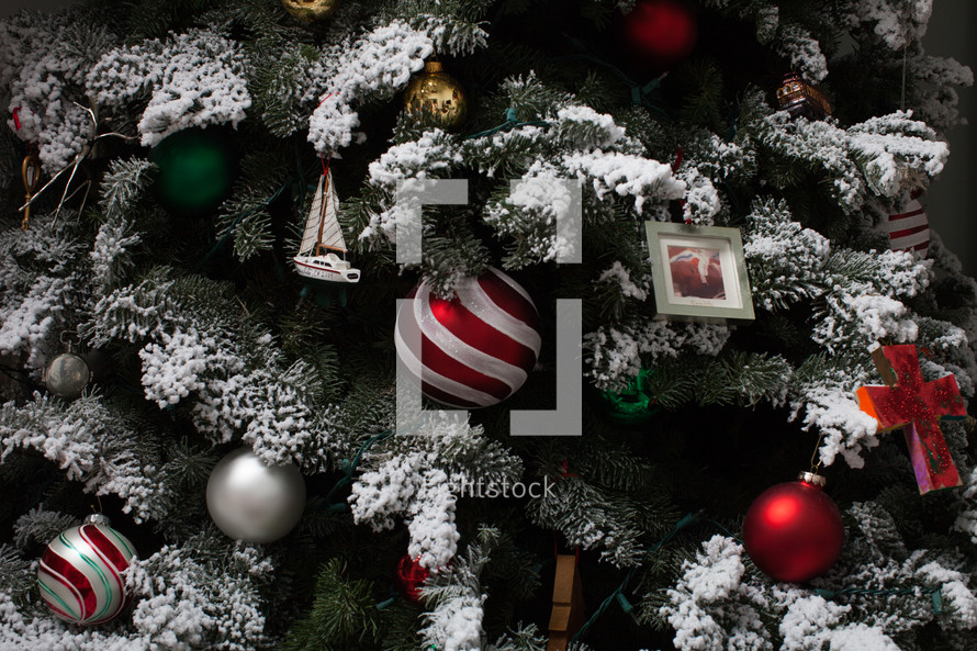 ornaments on a flocked Christmas tree