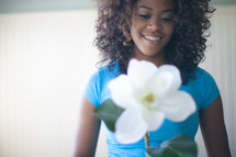 young woman holding a magnolia