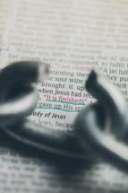 Broken chain link over Bible text -- John 19:30.