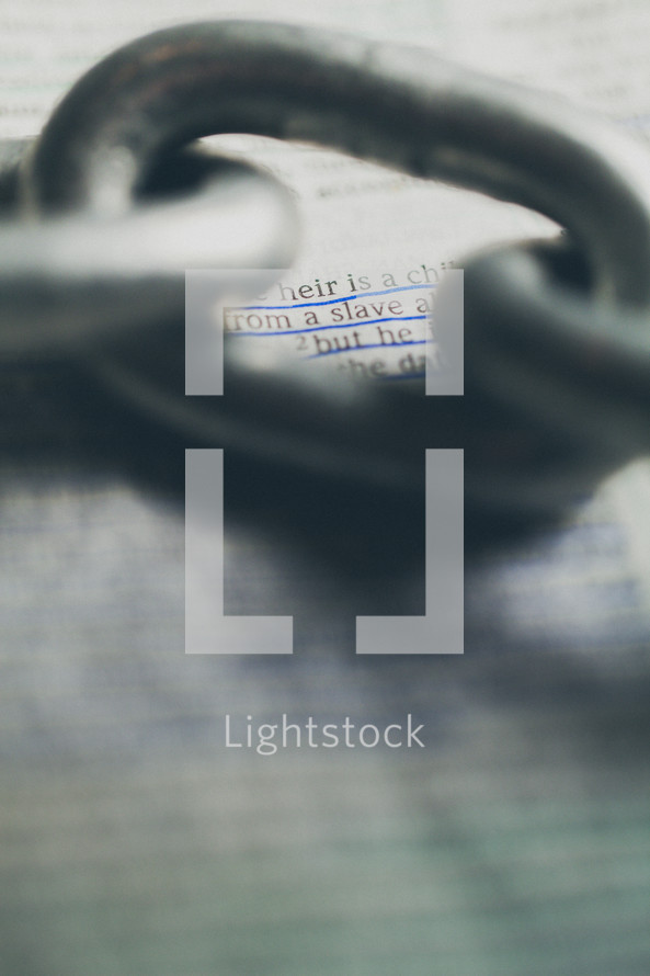 Chain link over Bible text.