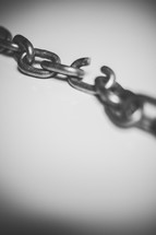 Chain with a broken link.