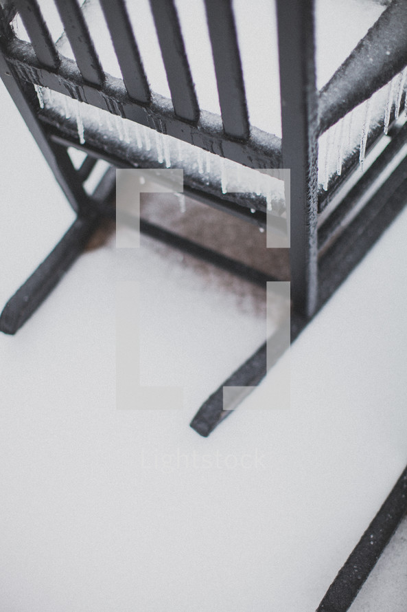 ice and snow on a rocking chair