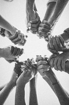 holding hands in a fellowship circle