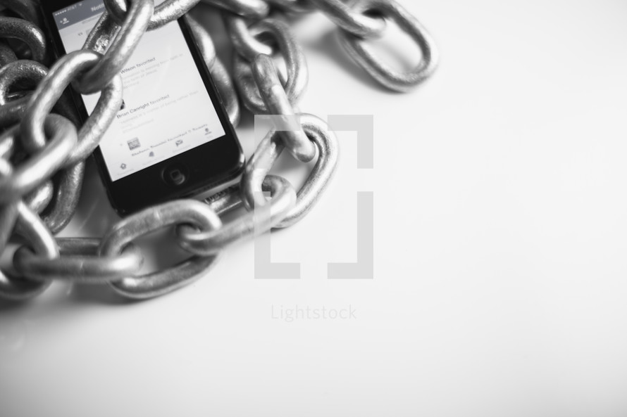 Cell phone wrapped in chains.