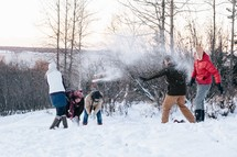 snowball fight outdoors in winter snow